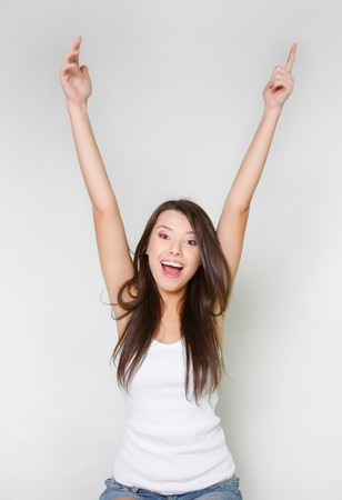 everyday people: happy attractive young girl with her hands up
