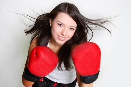 short gloves: studio shot of smiiling female boxer  Stock Photo