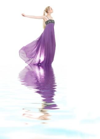 studio shot of beautiful woman in long purple dress photo