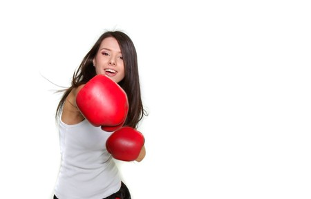 woman boxing gloves: young beautiful female boxer over white Stock Photo