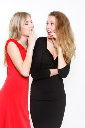 two young girls talking over white Stock Photo - 7770279