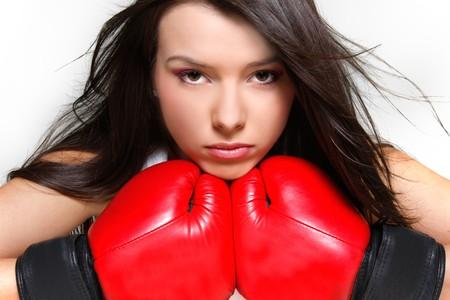 close up portrait of female boxer over white photo