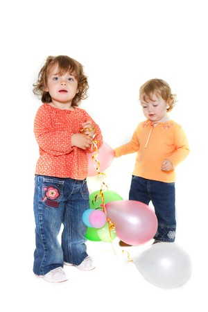 two cute toddler girls with balloons photo