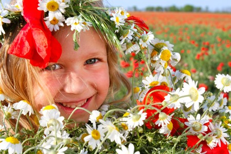 outdoor portrait of smiling girl with flowers photo