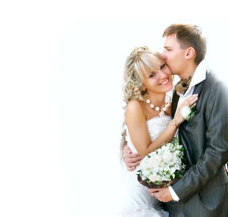bride bouquet: young happy couple on ther wedding day Stock Photo