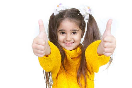 young girl showing her thumbs up over white Stock Photo - 7772029
