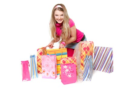young happy girl with shopping bags over white Stock Photo - 7771931