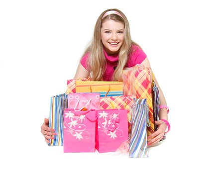 young happy girl with shopping bags over white Stock Photo - 7771932