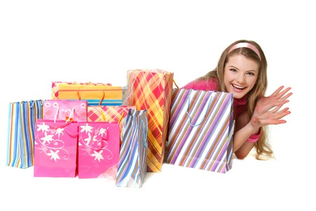 young happy girl with shopping bags over white Stock Photo - 7772104