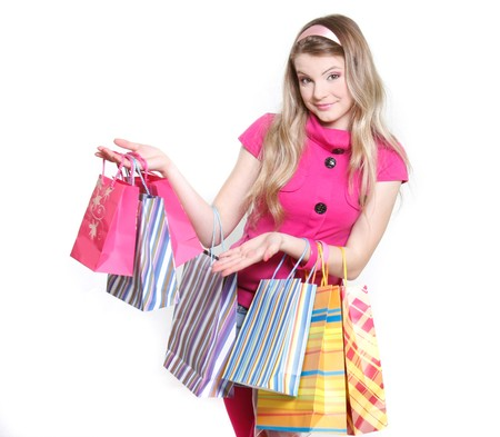 young girl with shopping bags over white Stock Photo - 7771852