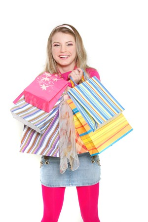 young happy girl with shopping bags over white Stock Photo - 7772149