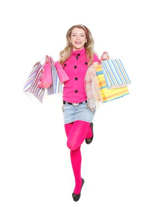 young happy girl with shopping bags over white Stock Photo - 7770783