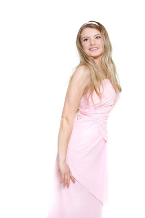 young beautiful woman in pink dress over white Stock Photo - 7771272