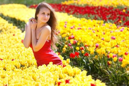 young beautiful woman in yellow tulips photo