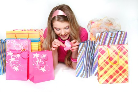 gril: young happy gril with shopping bags and gift over white