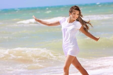 young happy girl on sea background Фото со стока