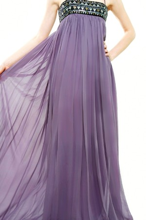 close up of young lady in long purple dress over white Stock Photo - 7771088