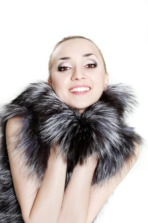 young beautiful woman in fur over white photo