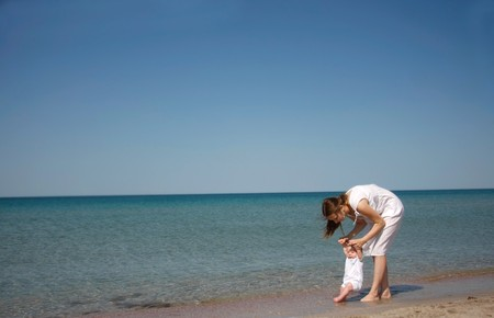 mother and baby on beach photo