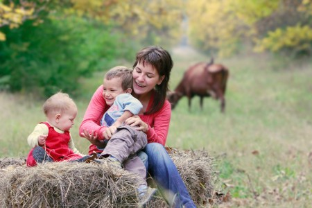 mother playing with two kids on nature Stock Photo