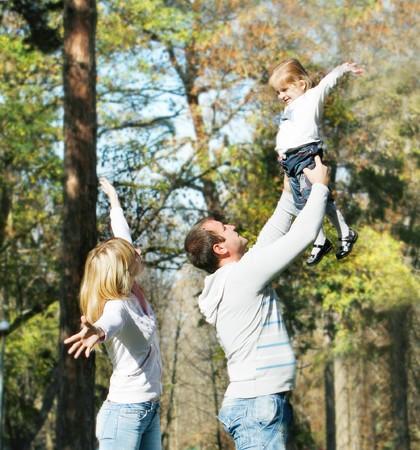 happy family in autumn park photo