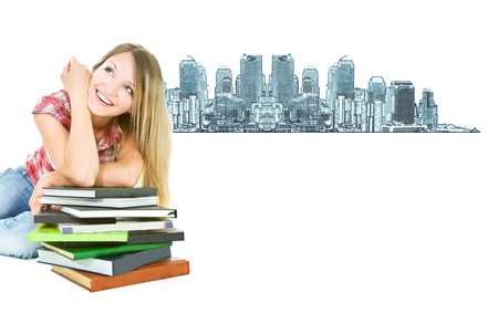 attractive student girl with pile of books on city background photo