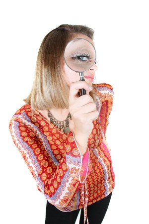 girl with magnifier glass photo