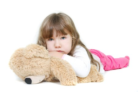 sad girl with teddybear over white