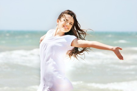 young happy girl on sea background Stock Photo