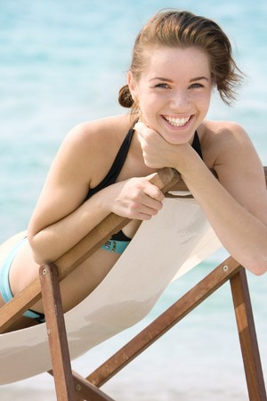 young smiling girl on beach photo