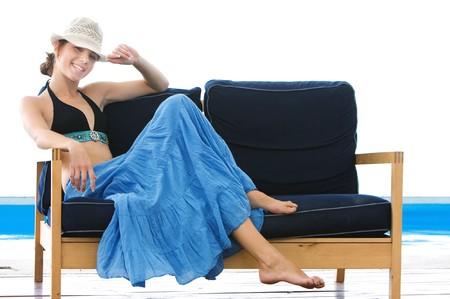 happy girl on beach sofa isolated over white photo