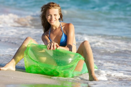 young happy woman on beach photo