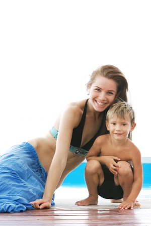 happy mother and son near swimming pool isolated over white photo