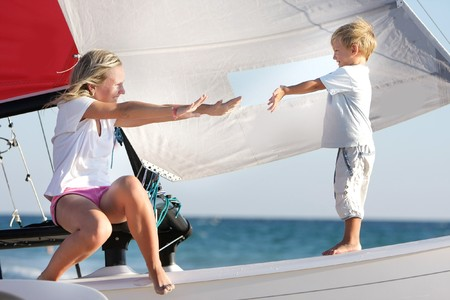 loving mother and son on board of sea yacht photo