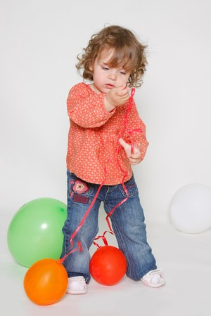 cute little girl playing with colorful balloons Stock Photo - 7804221