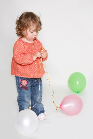 cute little girl playing with colorful balloons Stock Photo - 7791195