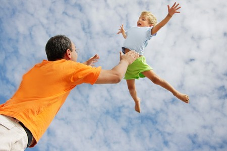 foster parenting: flying child on sky background