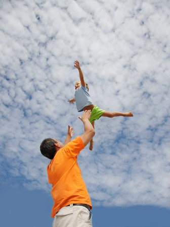 father and son on sky background photo