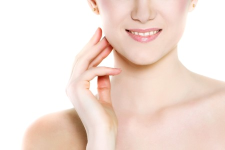close up portrait of young beautiful woman over white Stock Photo