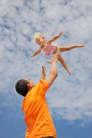 flying toddler girl on sky background Stock Photo