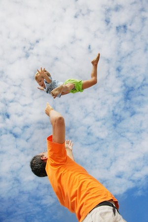 flying child on sky background photo