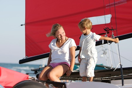 happy mother and son on sea yacht background photo