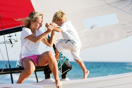 mother and son on board of sea yacht photo