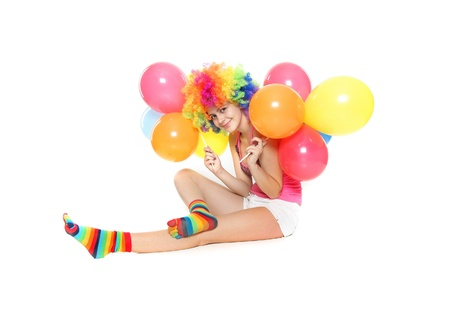 young happy woman with balloons over white