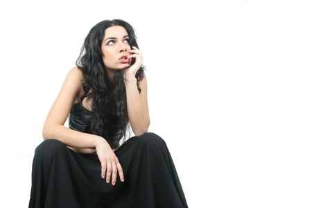 malcontent: young pensive woman over white Stock Photo
