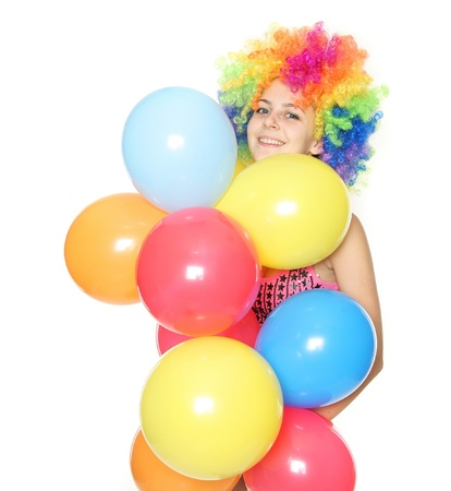 funny young woman with colorful balloons over white Stock Photo - 11909776