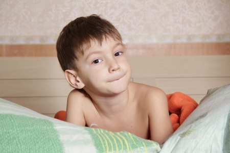 cute young boy in bed