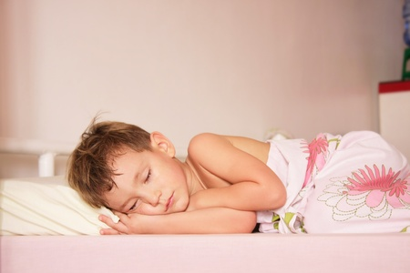 cute boy sleeping at home photo