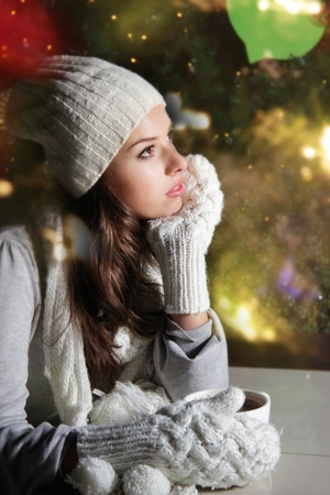 tea light: young attractive woman dreaming on lights background Stock Photo