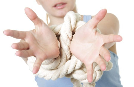 handcuffed: young woman with bounded hands Stock Photo